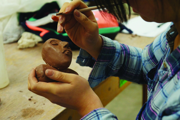 Judi Zhang | The Cento Students work on their solid-build form pieces in Sarah Hahn's Ceramics I class, making a bust out of a solid piece of clay.