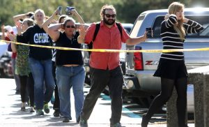 Students, staff and faculty are evacuated from Umpqua Community College in Roseburg, Ore. after a deadly shooting Thursday, Oct. 1, 2015. (Michael Sullivan /The News-Review via AP)