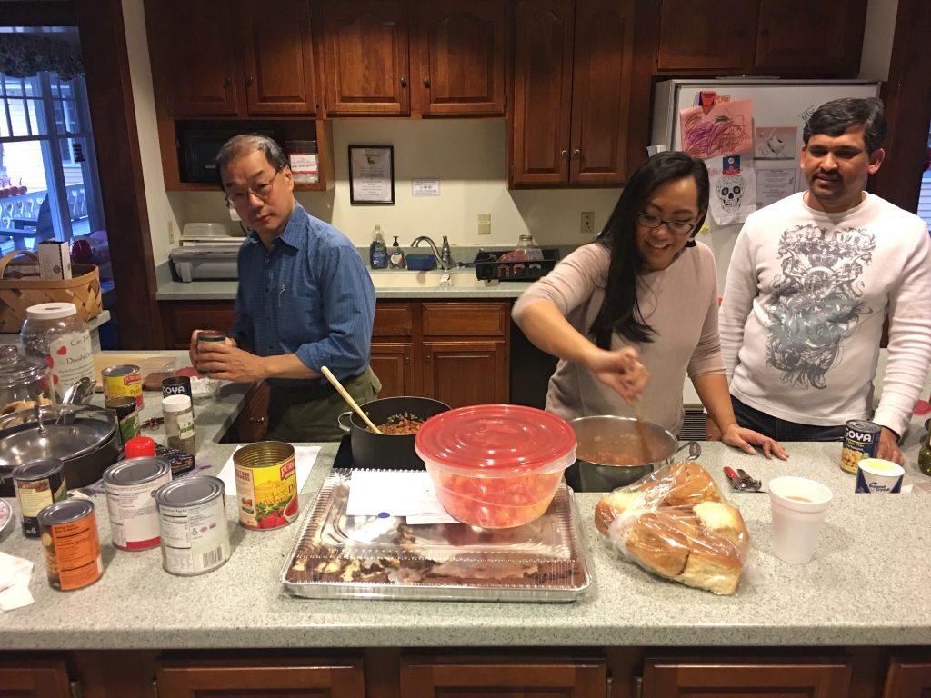 APIC members cooking at David's House