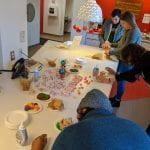 3 Students building graham cracker gingerbread houses