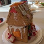 A gingerbread house with an orange starburst window.