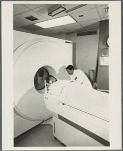 A woman being inserted into an MRI machine