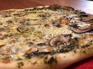 homemade pizza with mushroom and cheese.