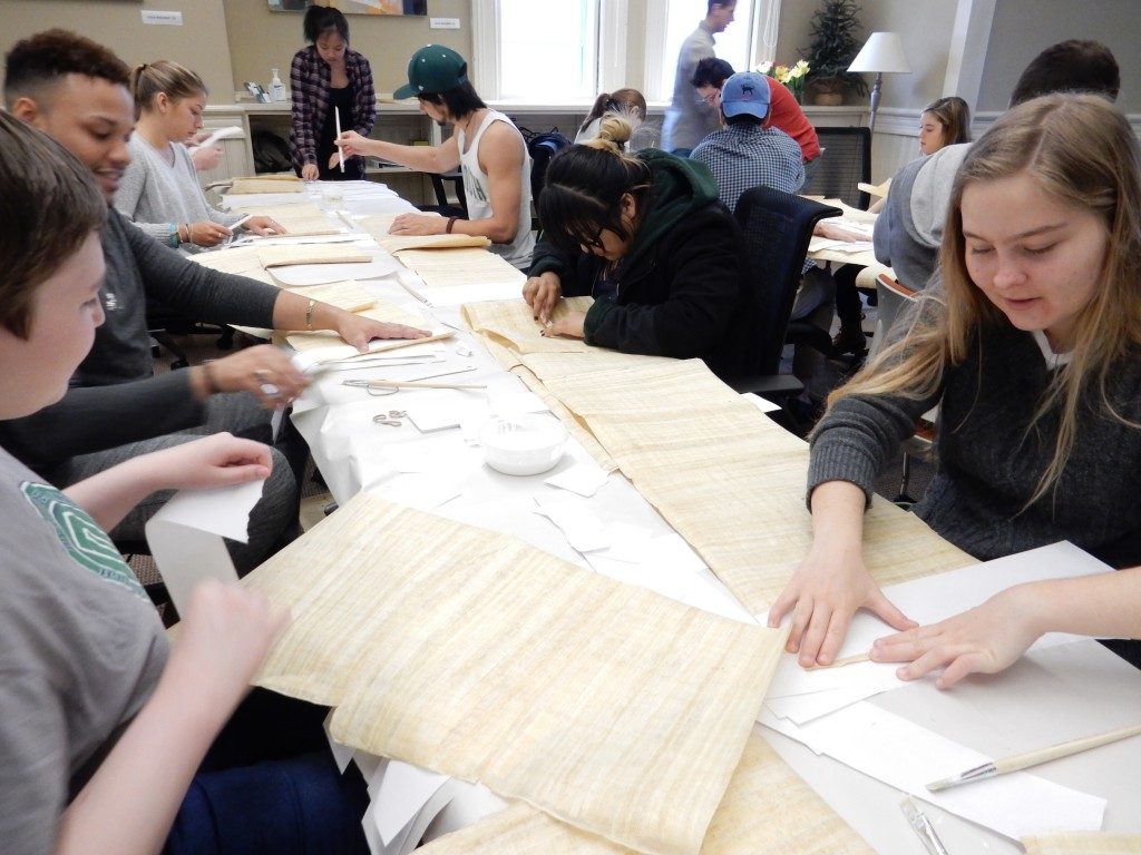 students_working_on_scrolls