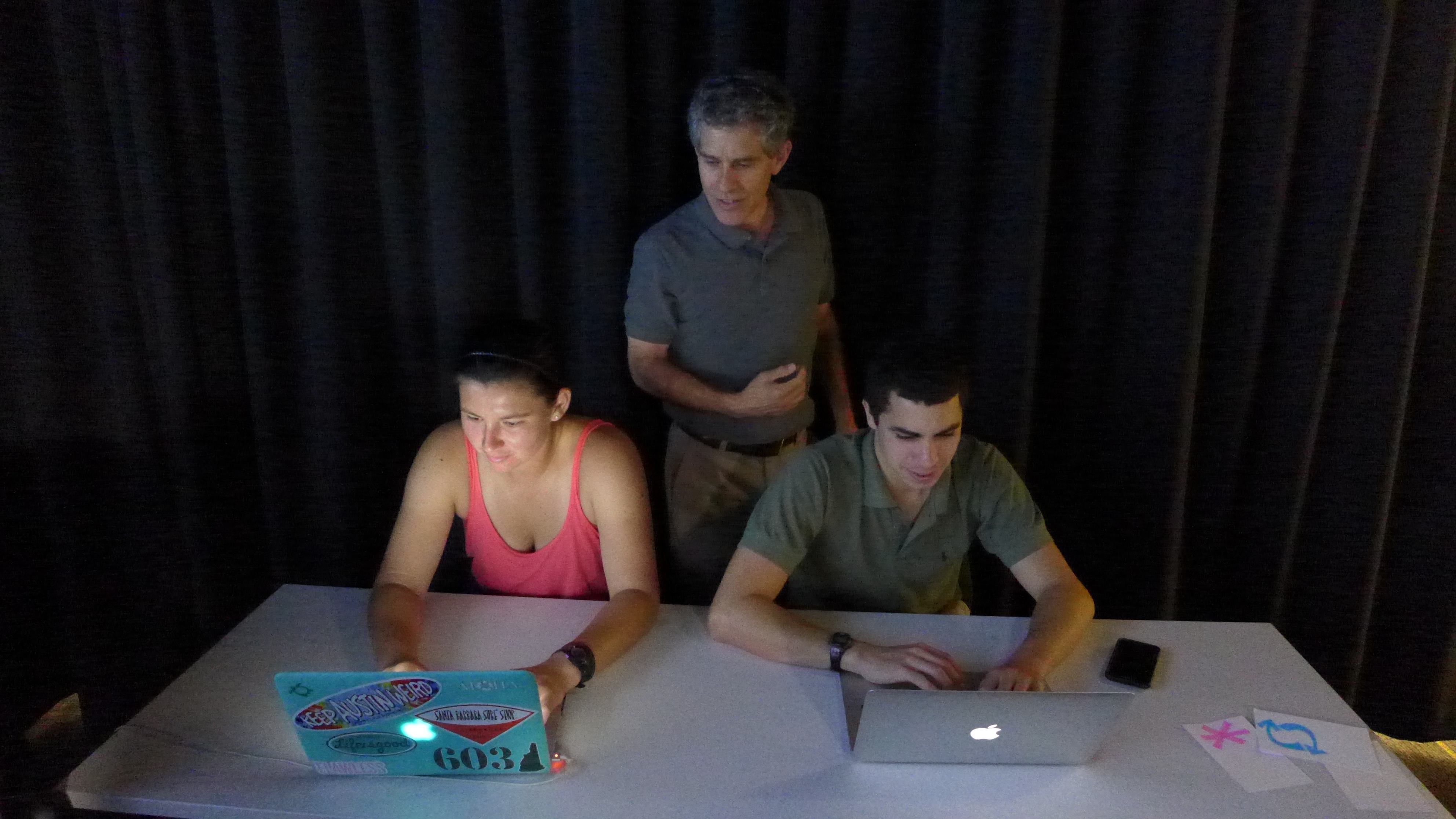 Chloe and Joby with Andy looking at questions