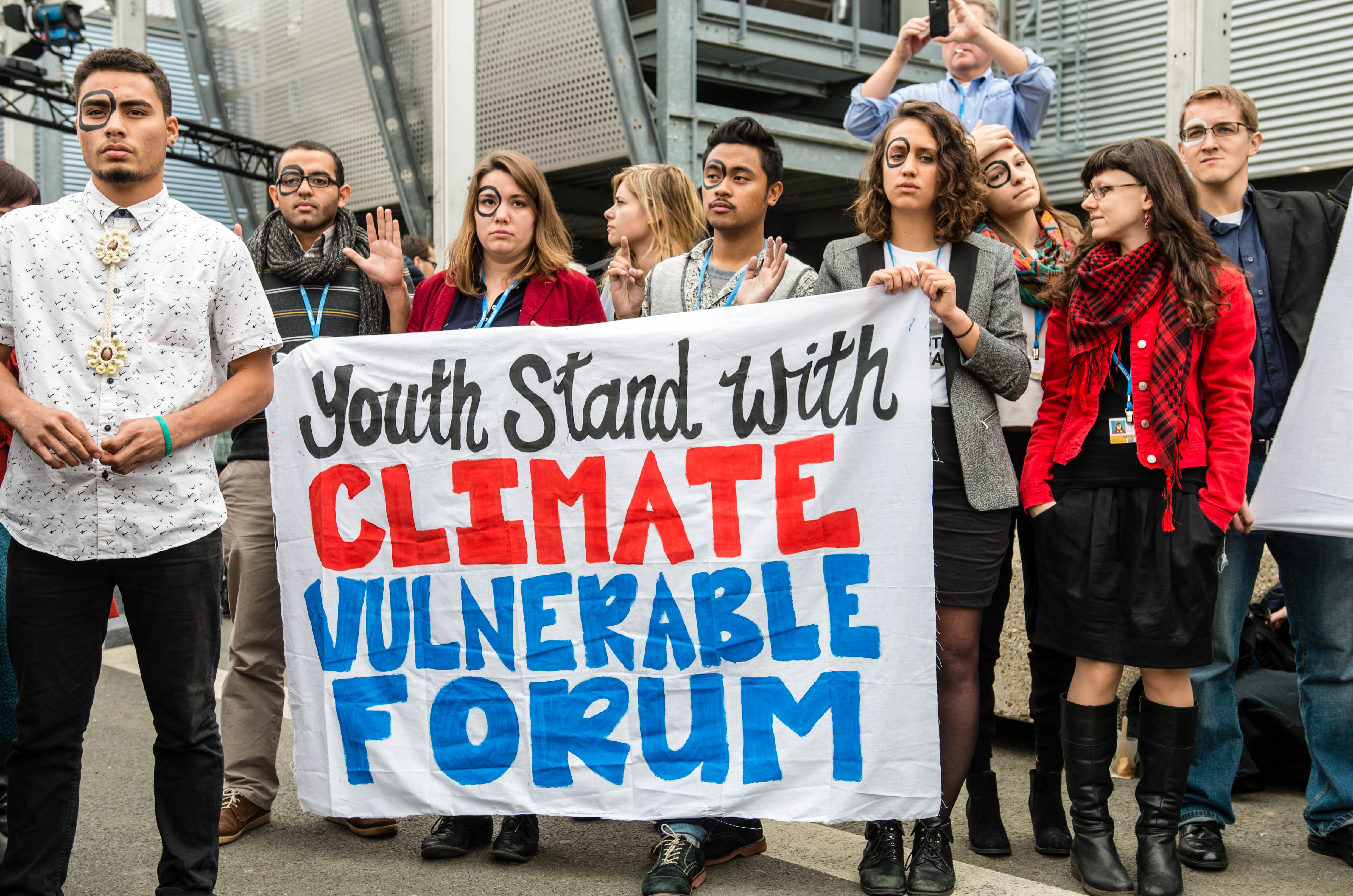 An action in support of the Climate Vulnerable Forum at COP21. Photo credit: SustainUS
