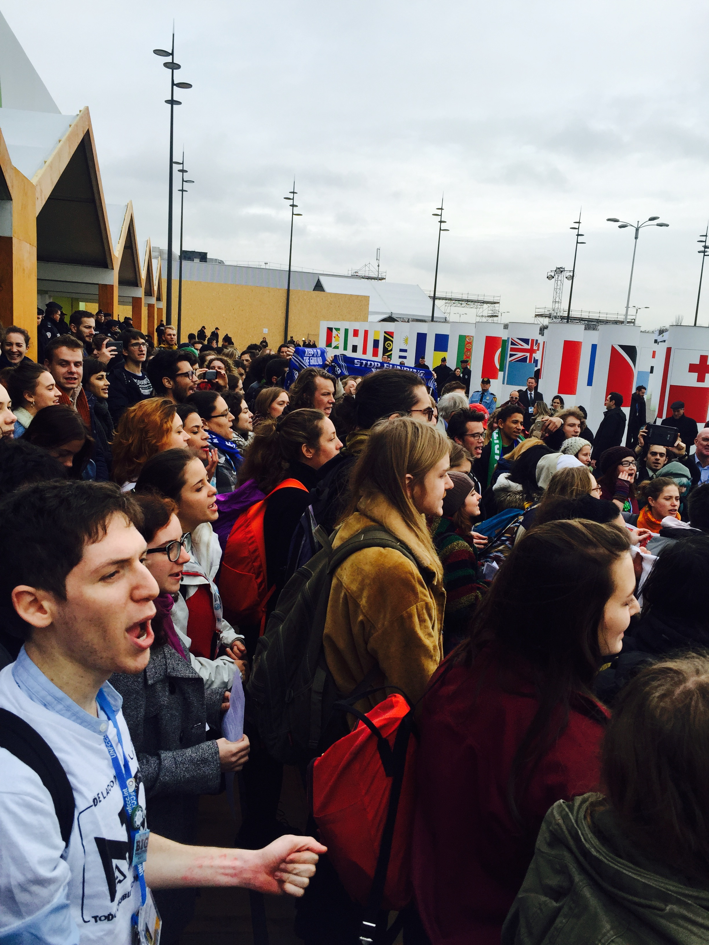 Young people leading an action at COP21 in Paris, France.