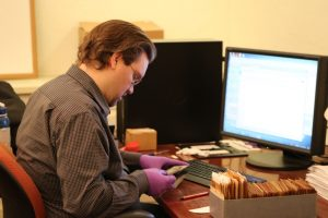 Wes Benash examines a negative. Note the nitrile gloves.