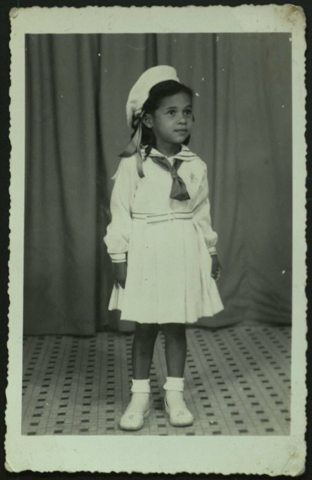 5-year old Rita in a religious school uniform.