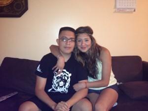 Eduardo with his older sister
