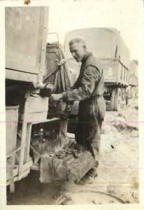 Chipman repairing one of the supply trucks.