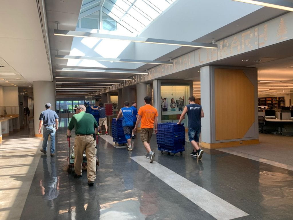 People move books from Feldberg Library to Baker-Berry Library