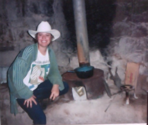 Mirtha next to the woodstove