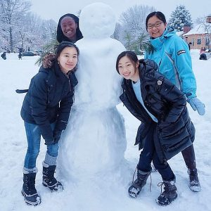 Leeya with her friends and a snowman
