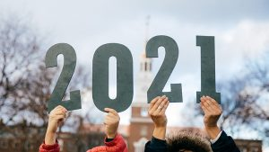 Picture of students holding up a class of 2021 sign