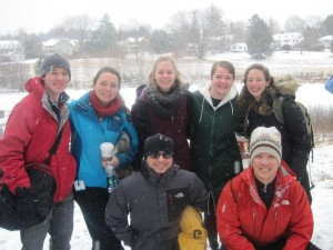 The team after completing the Polar Bear Plunge into frozen Occum Pond during Winter Carnival
