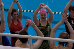 """The team doing its signature """"Party in the USA"""" cheer before a home meet"""