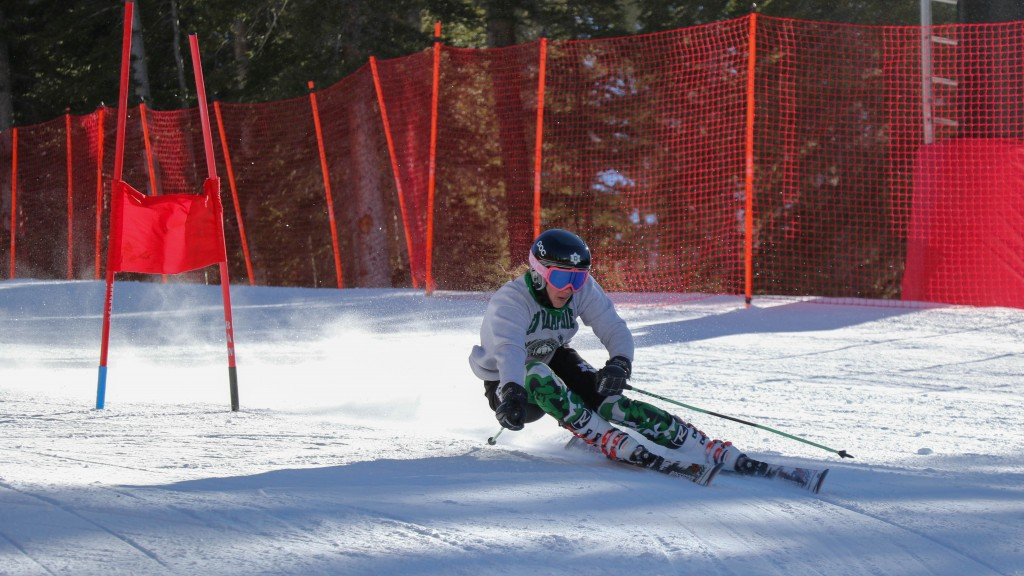 Maisie Ide '16 searches for speed at the end of a GS turn during training at Loveland