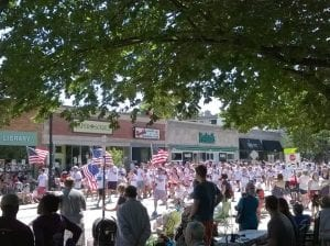 Waving with Pride: A sense of unity and nationalism among entries and spectators throughout the parade.