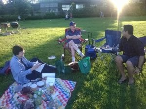 Post-Parade Picnic: Mary Helen and Lucas explaining the traditional way to have an authentic 4th of July picnic to Yoes.