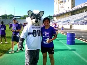 Posing with NU's mascot, Wildcat Wille at the Finish line in Ryan Field.