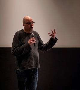 """Mark Nowak reads at """"Working Poems,"""" February 26th 2014. Photo courtesy of the Block Museum."""