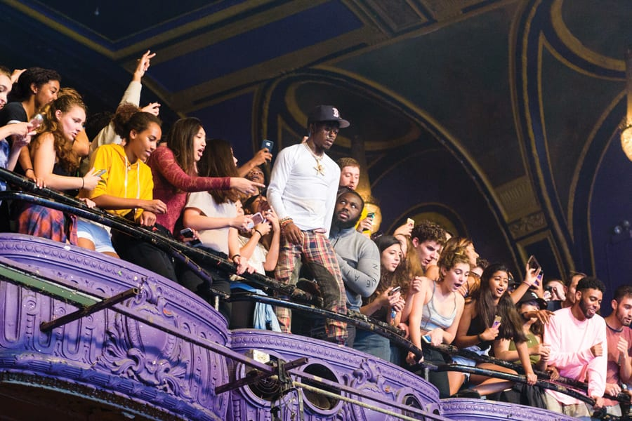 Lil Uzi Vert climbing the side of the Riviera Theatre at A&O Blowout 2017. Photo Credit: Jeffrey Wang, The Daily Northwestern