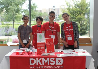 Students and staff volunteer at the DKMS bone marrow registry drive