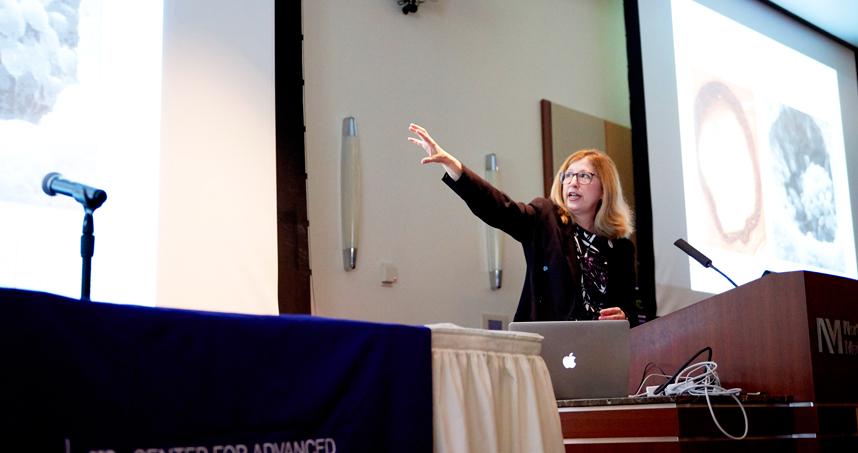 Teresa Woodruff presents at the CARE inaugural symposium.