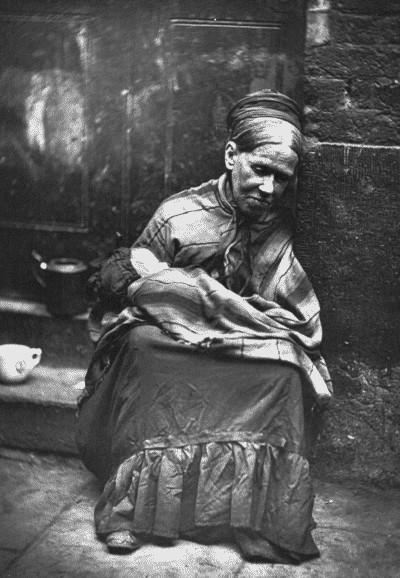 Woman living on street in London, 1876-77