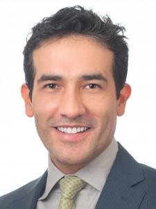 A headshot of Dr. Carlos Gallo.