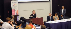 A photo of Dr. Karen Parker speaking to the attendees of the inaugural State of LGBT Health Symposium on August 18, 2016.