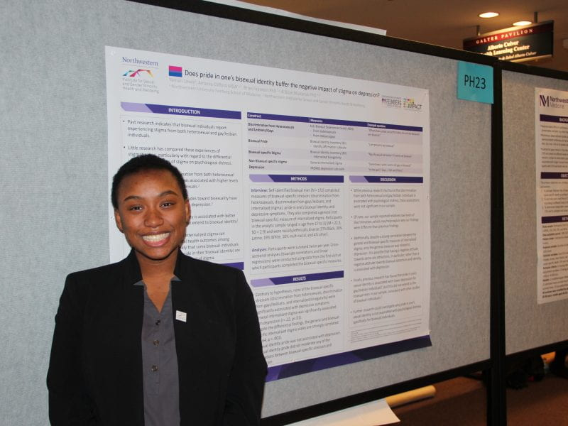 Yamari Lewis presents her poster at Research Day.