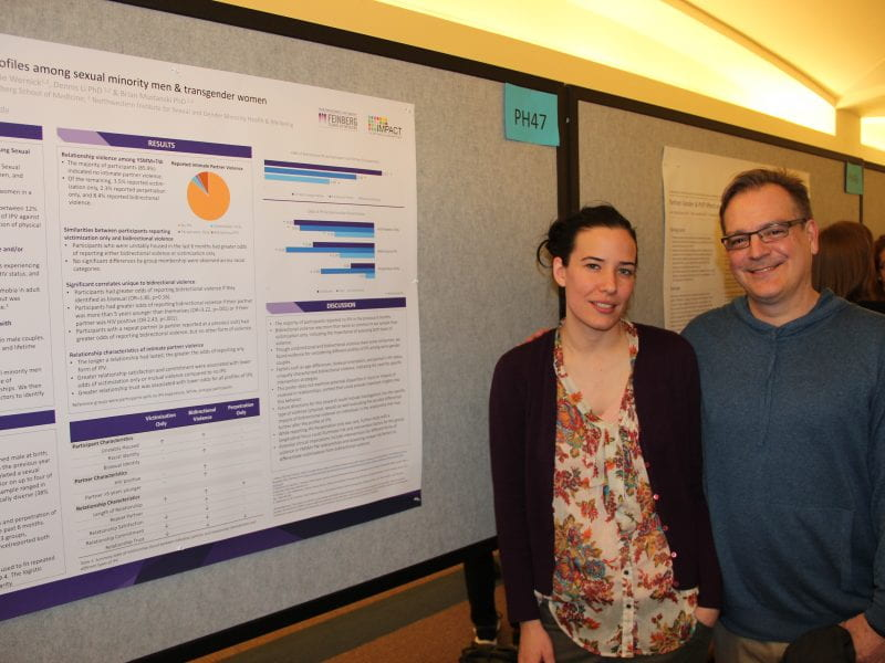Thom Remble with Antonia Clifford as she presents her poster at Research Day.