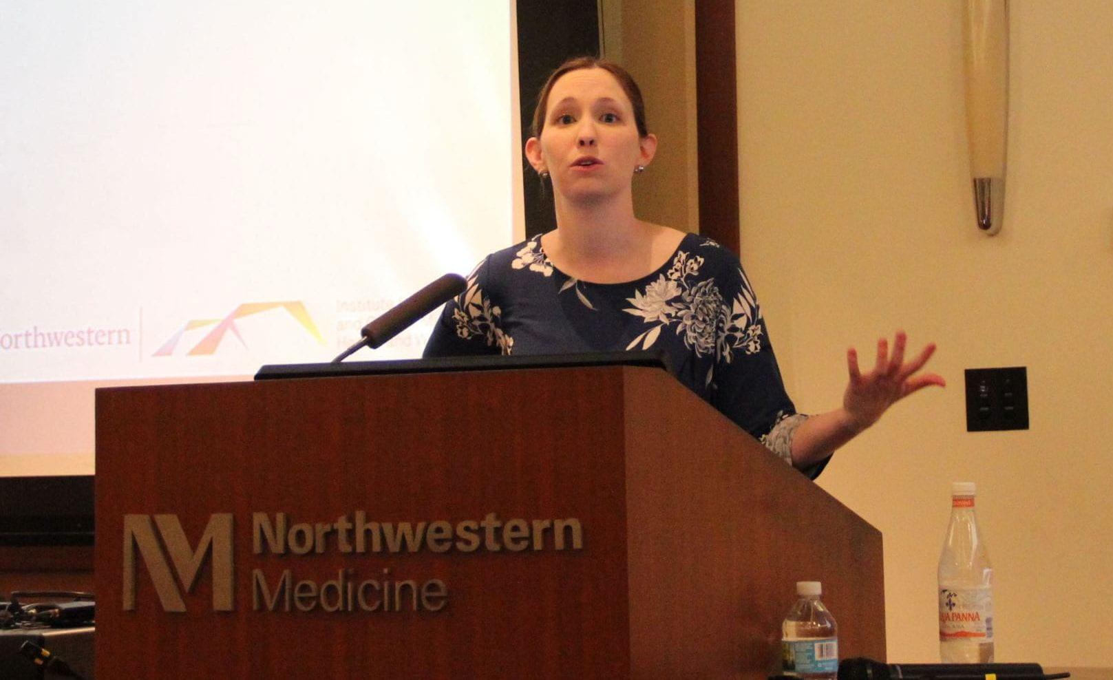 Dr. Christina Dyar giving a presentation on SGM-AFAB health disparities.