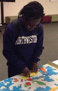 image of student working geographic puzzle