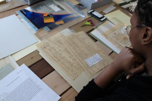 Maya Wallace looks over slave documents.