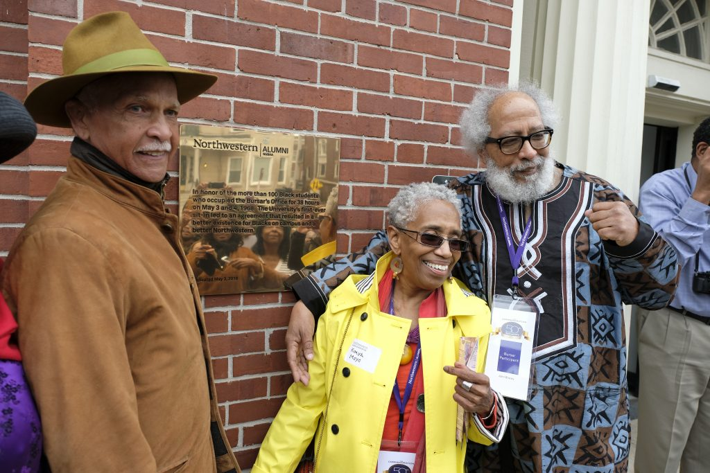 From left: Takeover participants Wayne Watson, Kimya Moyo, and John Bracey in front of the new plaque commemorating the 1968 protest at the Bursar's Office.