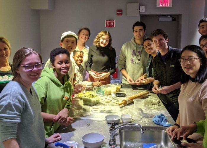 CCS residents in a kitchen making pierogi