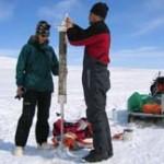 Sampling surface sediments, Baffin Island.