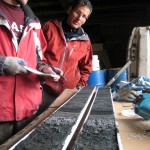 Examining tephra (volcanic ash) layers in a sediment core, on Adak Island in the central North Pacific Ocean.