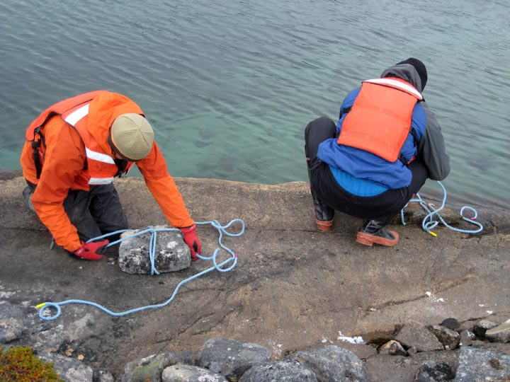 Greenland is windy. Here we're making anchors to keep the raft in place during the coring process.