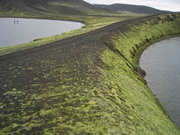 Coring a small volcanic lake, central Iceland.
