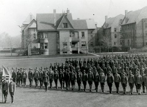 Photograph of a SATC drill, 1918. Taken on Northwestern's Evanston campus; Fraternity North Quad in the background.