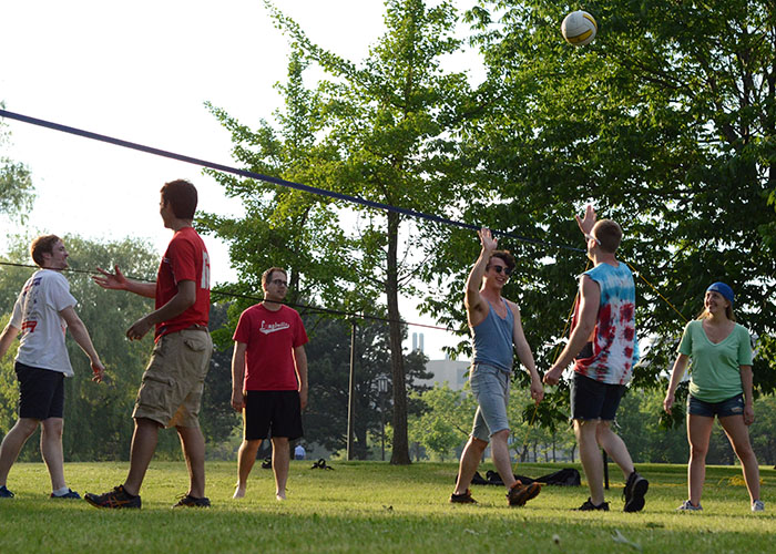 High stakes volleyball by the lake.