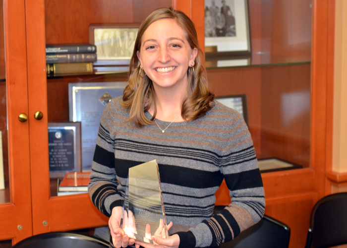 Sam with her award for Outstanding Researcher from IIN 2015.