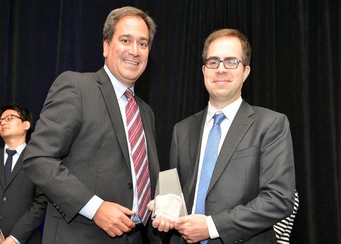 Joe receiving his IIN 2016 Outstanding Researcher award.