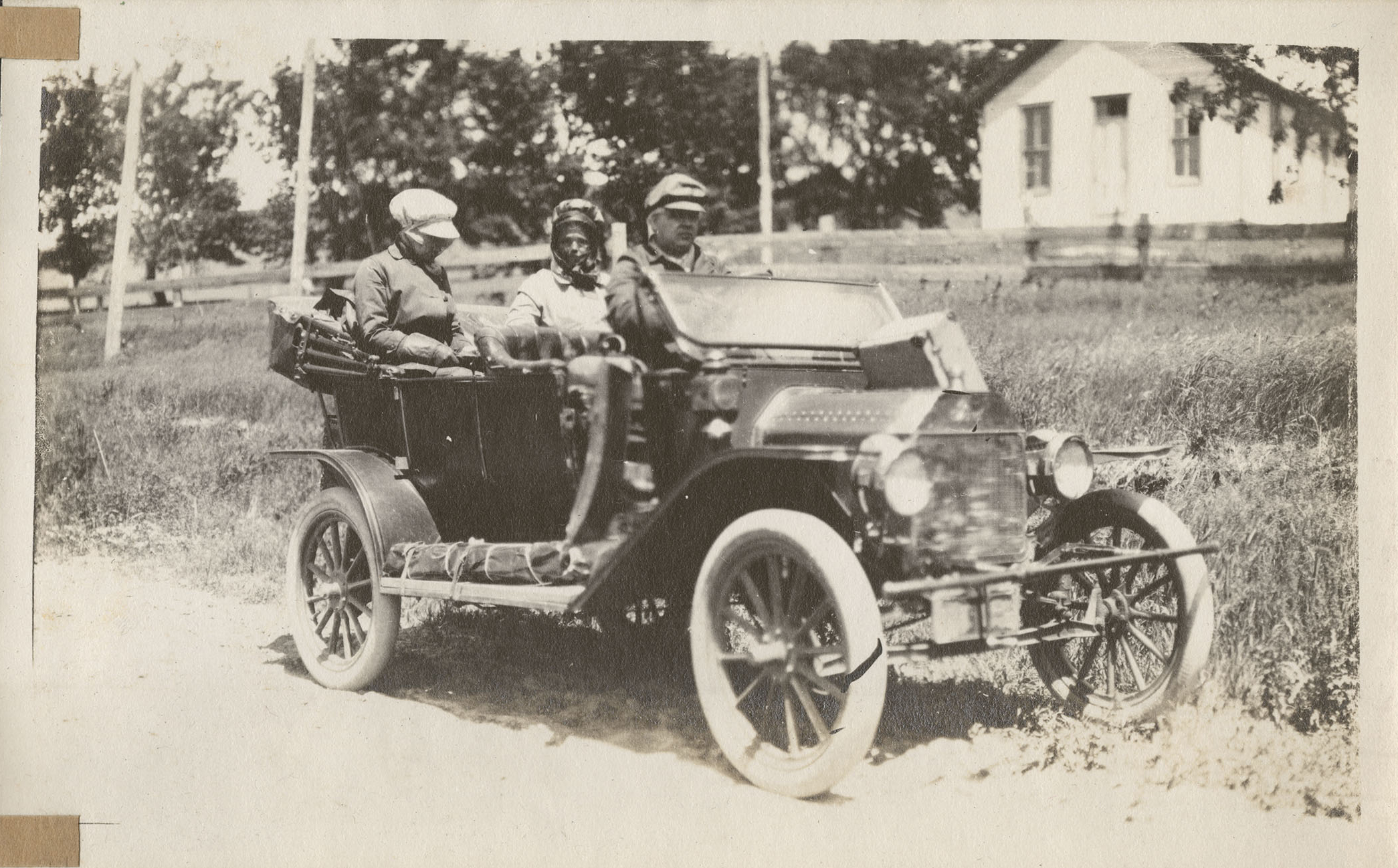 Three Passengers in a 1915 Model T