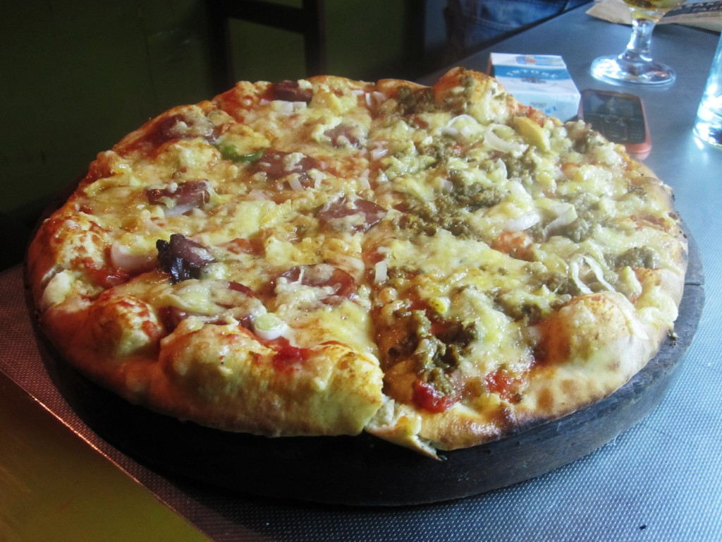Pizza: half-beef, half-sausage. The fresh cheese is what really makes this pizza!
