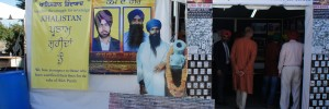 """This tent commemorates those who were disappeared by police in Punjab in the '80s and '90s. Pictured on the tent banner are Bhai Gurjit Singh and Bhai Krishan Bhagwan Singh, the two Sikhs killed by police in October protests. The cutout is of Jarnail Singh Bhindranwale. To the right of the cutout is a banner that reads """"Disappeared by the police: Victims of Government Repression."""" The photos on and in the tent show pictures of murdered Sikhs, but without proper documentation: no names, dates, locations, anything. The sparsity of solid evidence is a primary reason why the Indian government has been able to deny responsibility for so long."""